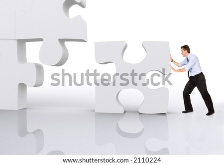 business man building a 3d puzzle over white