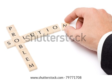 Business man building solution from problem over white background - stock photo