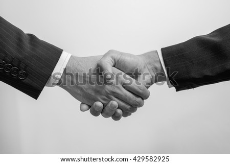 Business Man. Business handshake and business people. handshake on white. handshake Business  concept. Shake hands after their meeting. man handshake. black and white. - stock photo