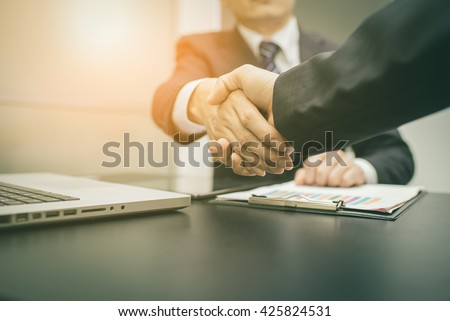 Business Man. Business handshake and business people , vintage tone - stock photo