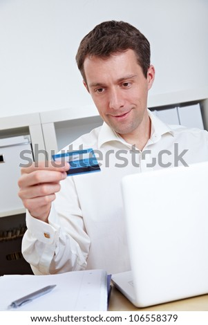 Business man buying online with credit card and laptop - stock photo