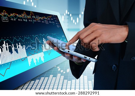 Business man calculating the digital tablet - stock photo