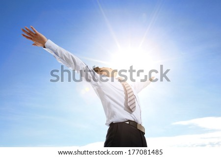 Business man carefree outstretched arms with sky and cloud, asian people - stock photo