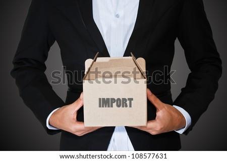 Business man carry box - stock photo