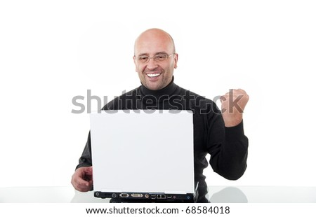 Business man celebrating his success with a computer laptop isolated on white background - stock photo
