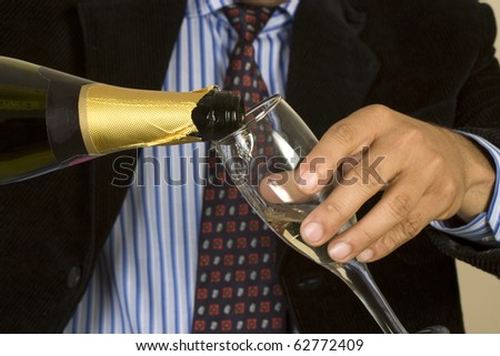 business man celebrating success, pouring champagne - stock photo