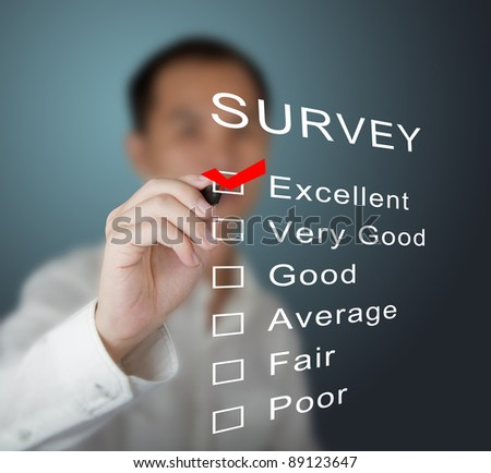 business man checking  excellent on survey form - stock photo