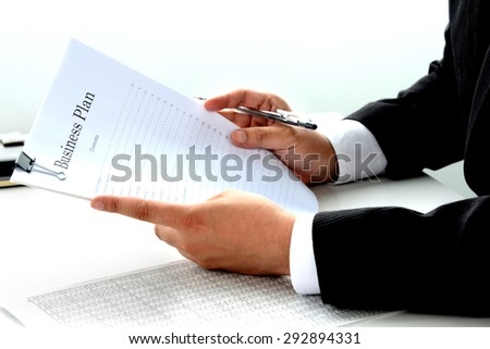 Business man checking for business plan document