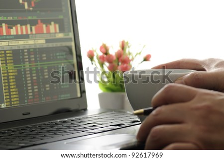 Business man checking stock diagram in office
