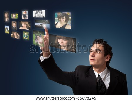 Business man choosing photos from digital gallery