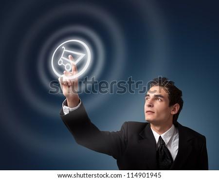 business man choosing shopping cart button - stock photo