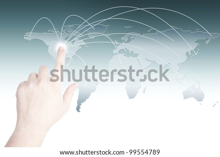Business man clicking the touch screen for social network or business connection with world map - stock photo