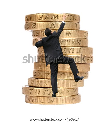 business man climbing some pound coins - stock photo