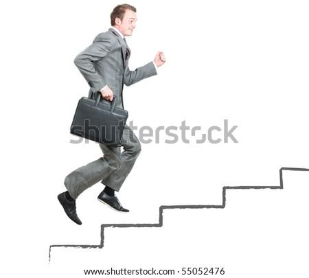 Business man climbing the corporate ladder - stock photo