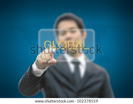 Business man concept hand pointing button global word with world map background