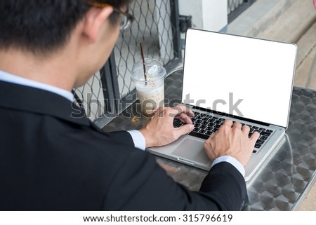 business man concept photo using laptop computer with blank computer screen with selective focus on laptop computer - stock photo