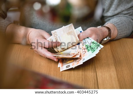 business man counts banknotes Euro. Euro currency from Europe, Euros. - stock photo