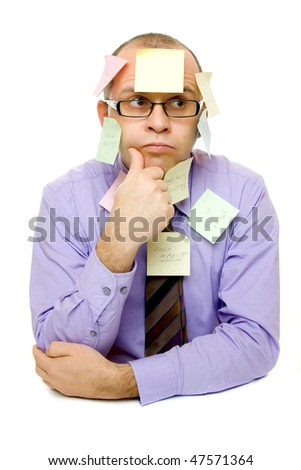 Business man covered with sticky notes isolated on white