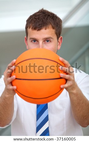 Business man covering his face with a basketball - stock photo