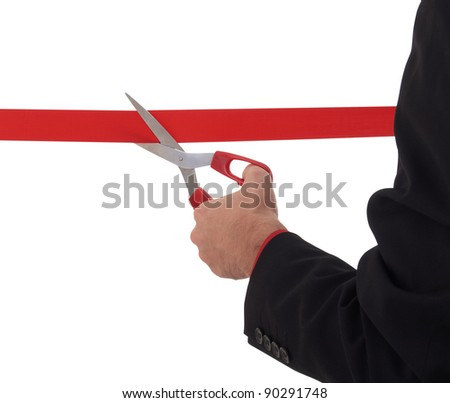 business man cutting a red ribbon with  scissors - stock photo