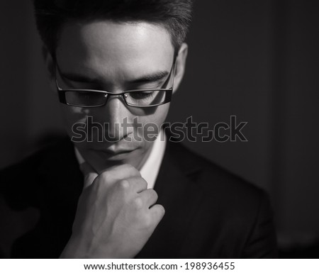 Business man deep in thought. - stock photo