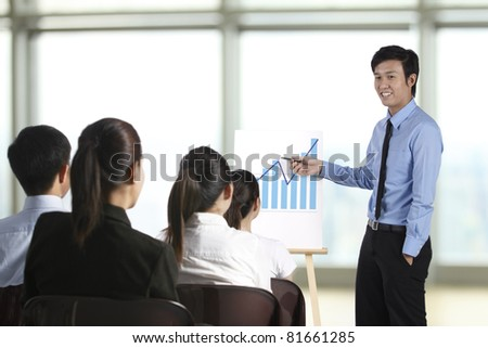 Business man discussing finance chart in meeting room - stock photo
