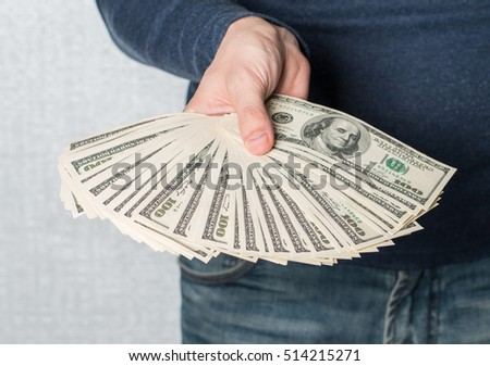 Business Man Displaying a Spread of dollars Cash