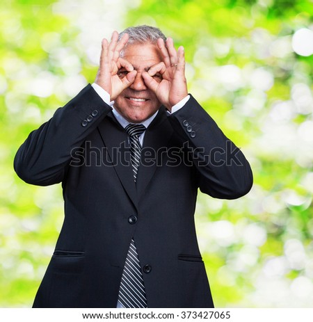 business man doing a glasses gesture - stock photo