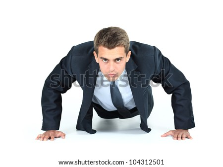 Business man doing push-ups - stock photo