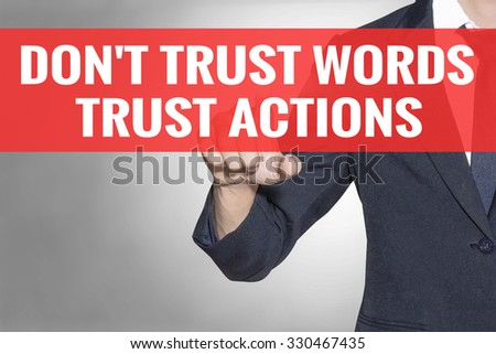 Business man Dont Trust Words Trust Actions word touching on red tab virtual screen for business concept - stock photo