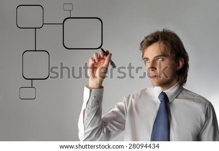 Business man drawing a digital graph - stock photo