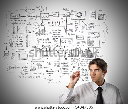 business man drawing a graphic - stock photo