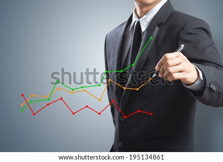 Business man drawing a growing chart - stock photo
