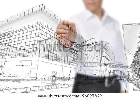 Business Man Drawing building and cityscape - stock photo