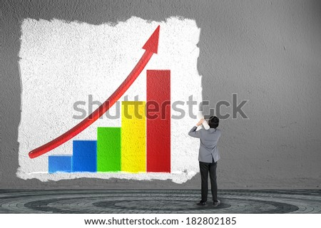 Business man drawing business graph - stock photo
