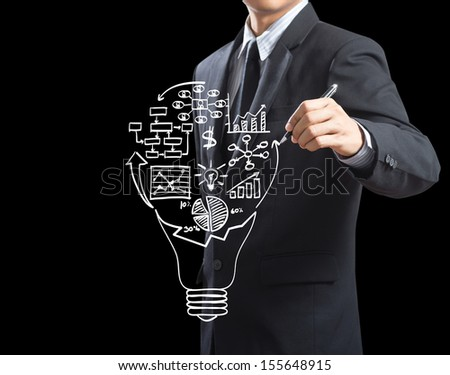 Business man drawing business strategy plan in light bulb - stock photo