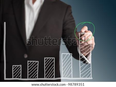Business man drawing chart - stock photo