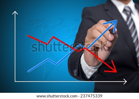 Business man drawing empty increase and decline graph over blue background - stock photo