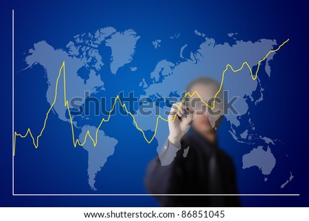 business man drawing fluctuate upward trend graph on world map - stock photo