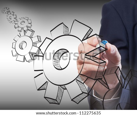 Business man drawing gear to success - stock photo
