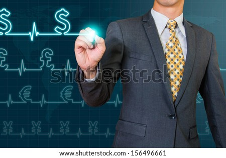 business man drawing  glow wave of world currency sign - stock photo