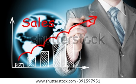 business man drawing graph of sales - stock photo