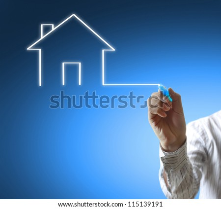 Business man drawing house in a whiteboard - stock photo