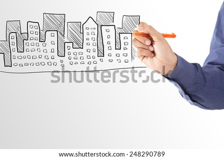Business man drawing house of property - stock photo