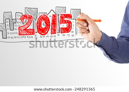 Business man drawing house of property in year 2015 - stock photo