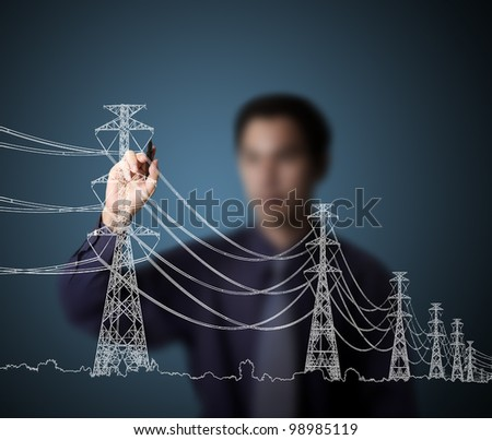 business man drawing industrial electric pylon and wire - stock photo