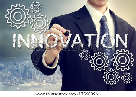 Business Man Drawing Innovation Concept with Gears - stock photo