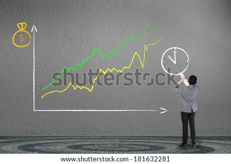 Business man drawing investor stock index graph - stock photo