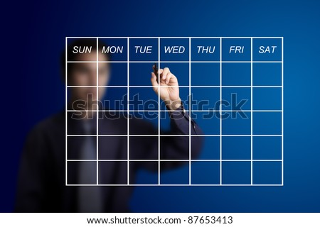 business man drawing schedule - stock photo