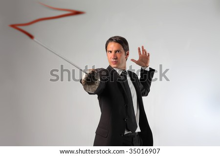 business man drawing with a sword  the z of Zorro - stock photo